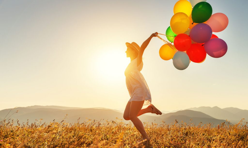 Woman running with balloons